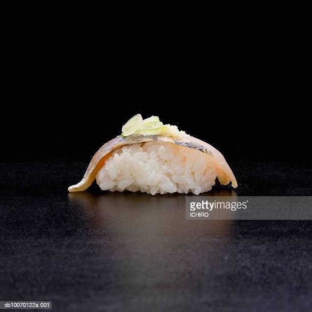 nigiri sushi on black background - jack fish stock pictures, royalty-free photos & images