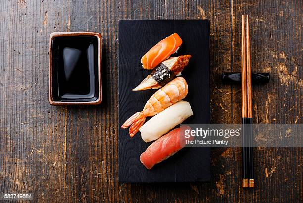 Nigiri sushi set and soy sauce on wooden table background