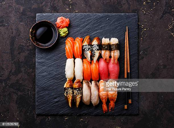 Nigiri Sushi Set on black stone slate plate board
