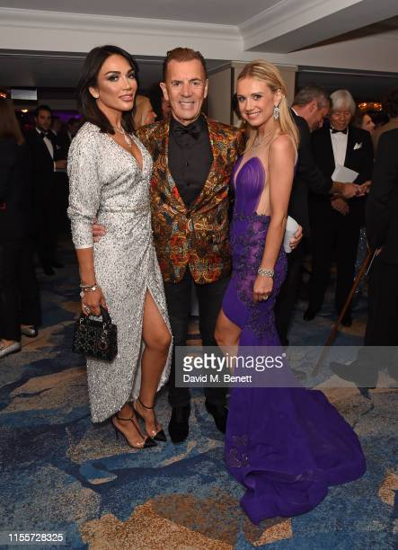 Nigora Whitehorn Duncan Bannatyne and guest attend The Caudwell Children Butterfly Ball at The Grosvenor House Hotel on June 13 2019 in London England