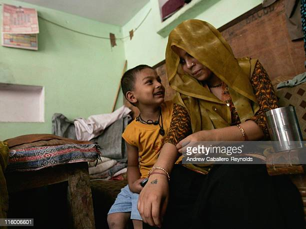 Niha a tuberculosis patient being treated by operation ASHA shares a light moment with her brother in a room she shares with 5 other family members...