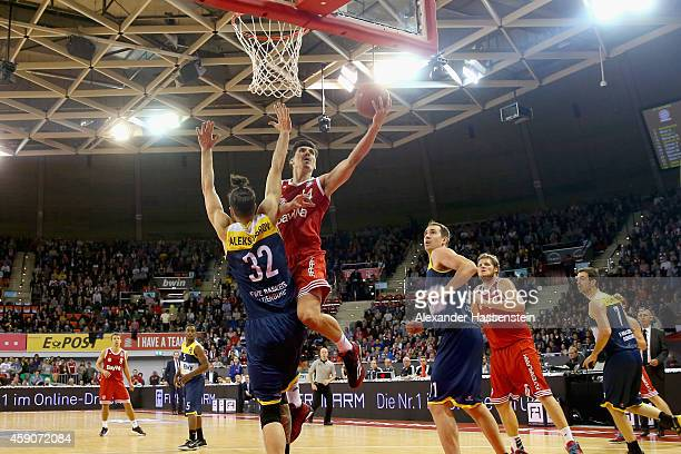 Nihad Djedovic of Muenchen scores a point against Nemanja Aleksandrov of Oldenburg during the Beko Basketball Bundesliga match between FC Bayern...