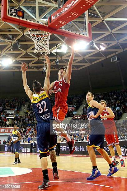 Nihad Djedovic of Muenchen scores a point against Nemanja Aleksandrov of Oldenburg during the Beko Basketball Bundesliga match between FC Bayern...