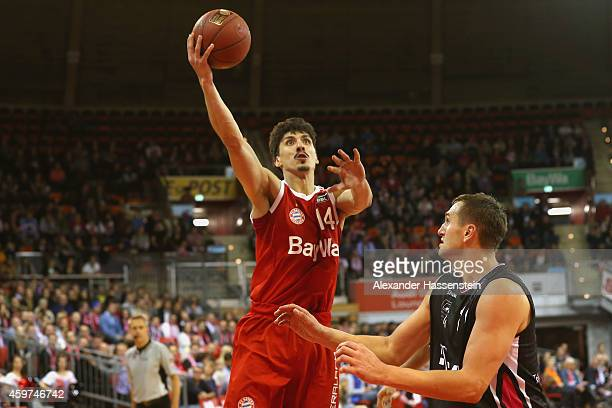 Nihad Djedovic of Muenchen scores a point against Tadas Klimavicius of Bonn during the Beko Basketball Bundesliga match between FC Bayern Muenchen...