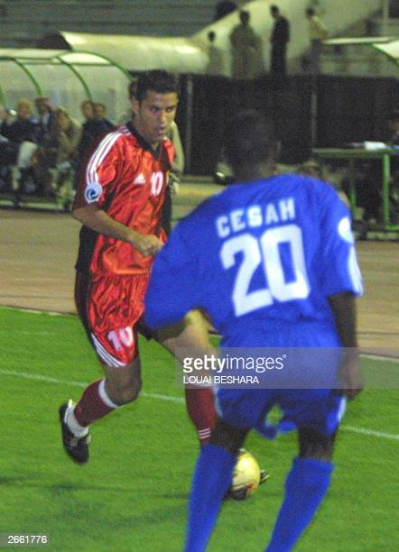 Nihad Haj Mustafa of the Syrian alJeesh club vies for the ball against Saudi alHilal's Gato Cesah during their Arab Champion's League match in...