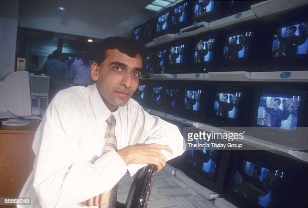 Nihal Shah standing near Televisions at Consumer Electronic shop