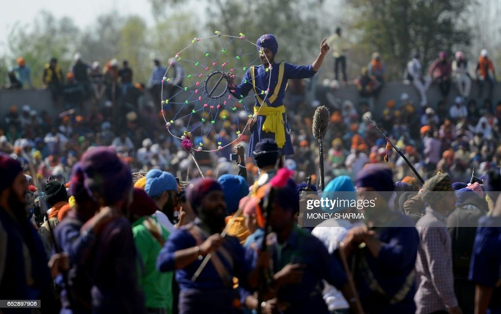 A Nihang a Sikh man who belongs to the armed Sikh order performs `Gatka` an ancient form of Sikh martial art during the Hola Mohalla festival in...