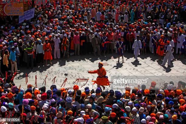 Nihang or Sikh warriors performing stunts with swords during Hola Mohalla celebrations at Anandpur sahib in Rupnagar