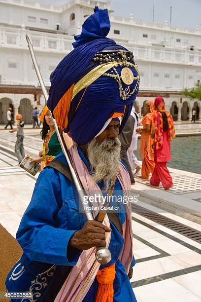 Nihang Sikh guard with huge turban, at the Golden Temple in Amritsar. The Golden Temple is the most sacred temple for the Sikh religion. Nihang Sikh...