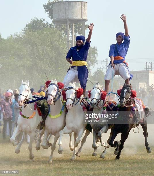 Nihang Singh performs his martial art skills on the occasion of Bandi Chhor Divas on October 20 2017 in Amritsar India Bandi Chhor Divas is a Sikh...