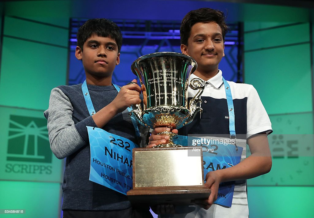 Nihar Saireddy Janga (L) of Austin, Texas, and Jairam Jagadeesh Hathwar of Painted Post, New York, hold a trophy after the finals of the 2016 Scripps National Spelling Bee May 26, 2016 in National Harbor, Maryland. Both spellers were declared co-champions at the end of the annual spelling competition.