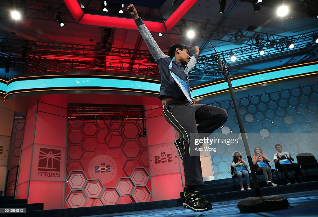 Nihar Saireddy Janga of Austin, Texas, celebrates after correctly spelling his word in the finals of the 2016 Scripps National Spelling Bee May 26, 2016 in National Harbor, Maryland. Students from across the country gathered to competed for top honor of the annual spelling championship.