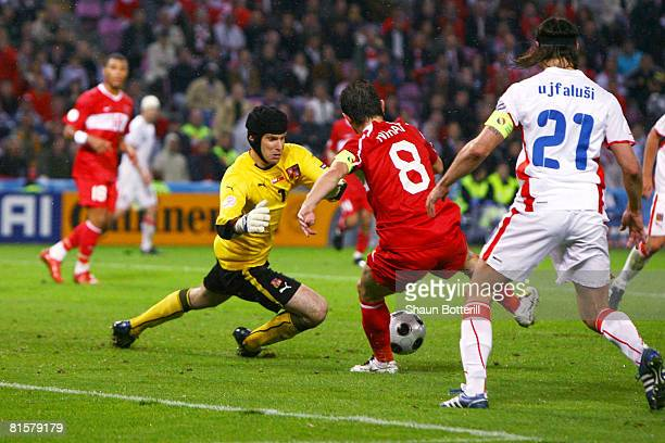 Nihat Kahveci of Turkey celebrates after scoring his team's second goal past goalkeeper Petr Cech of Czech Republic during the UEFA EURO 2008 Group A...