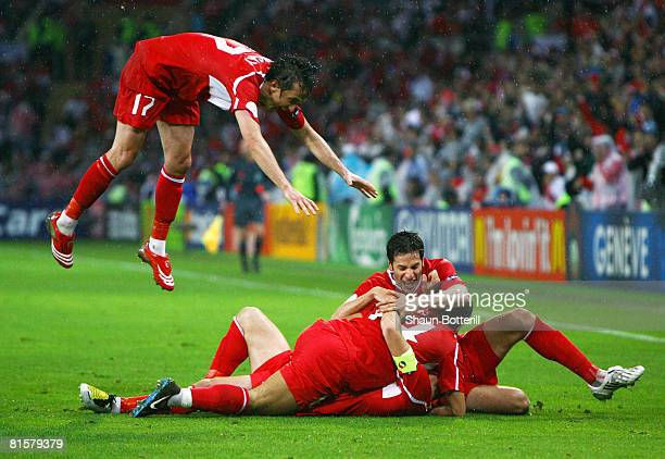 Nihat Kahveci of Turkey is congratulated by team mates after scoring his team's third and winning goal during the UEFA EURO 2008 Group A match...