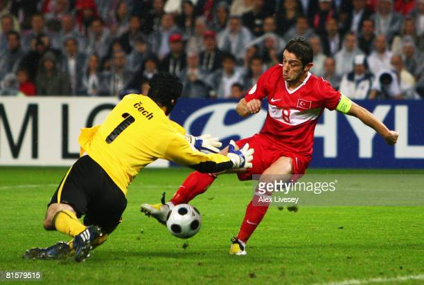 Nihat Kahveci of Turkey scores his team's second goal past goalkeeper Petr Cech of Czech Republic during the UEFA EURO 2008 Group A match between...