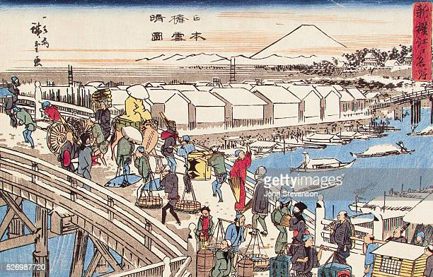 Nihonbashi The Bridge of Japan was traditionally the very center of the country It was always bustling with activity this lively print gives an...