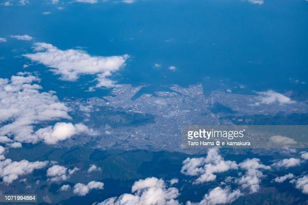 Niihama city in Ehime prefecture and Seto Inland Sea in Japan daytime aerial view from airplane