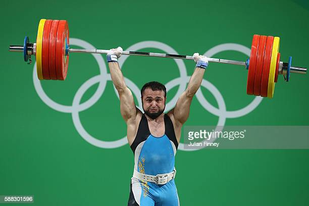 Nijat Rahimov of Kazakhstan lifts during the Men's 77kg Group A weightlifting contest on Day 5 of the Rio 2016 Olympic Games at Riocentro - Pavilion...