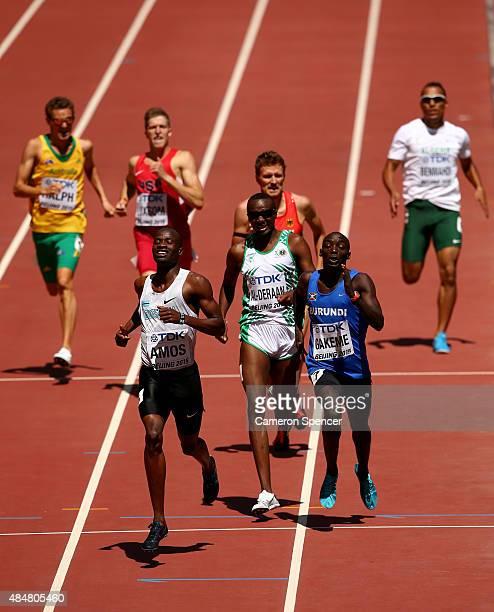 Nijel Amos of Botswana, Ali Al-Deraan of Saudi Arabia and Antoine Gakeme of Burundi cross the line in the Men's 800 metres heats during day one of...