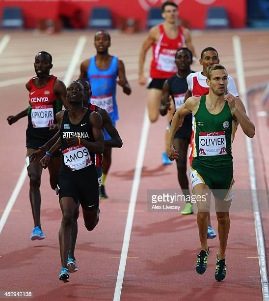 Nijel Amos of Botswana and Andre Olivier of South Africa compete in the Men's 800 metres semi-final at Hampden Park during day seven of the Glasgow...