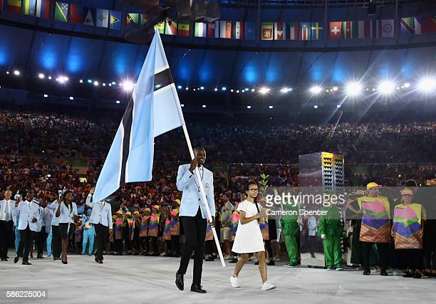 Nijel Amos of Botswana carries the flag during the Opening Ceremony of the Rio 2016 Olympic Games at Maracana Stadium on August 5, 2016 in Rio de...