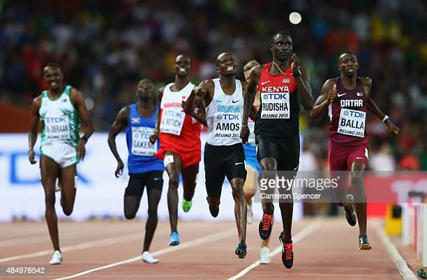 Nijel Amos of Botswana, David Lekuta Rudisha of Kenya and Musaeb Abdulrahman Balla of Qatar cross the finish line in the Men's 800 metres semi-final...