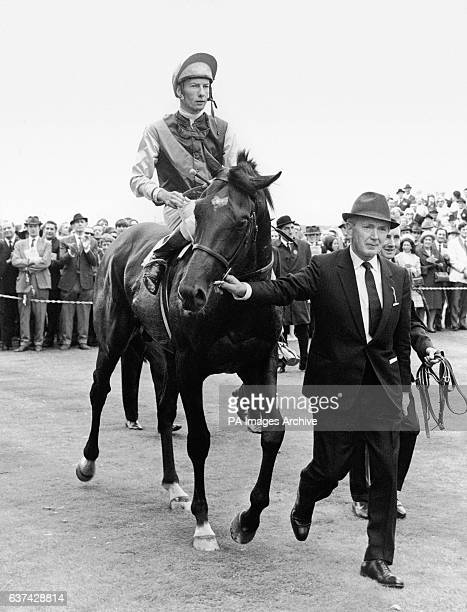 Nijinsky ridden by Lester Piggott is led in by trainer Vincent O'Brien after winning the race