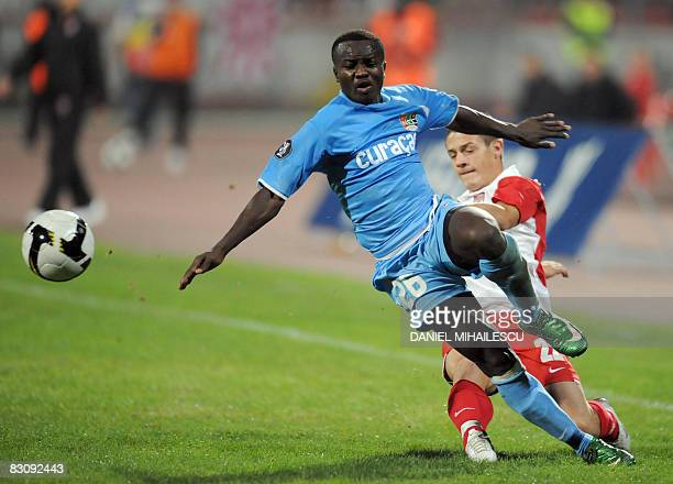 NEC Nijmegen's Saidi Ntibazonkiza is tackled by Dinamo Bucharest's Gabriel Torje during their UEFA CUP first round second leg football match in...