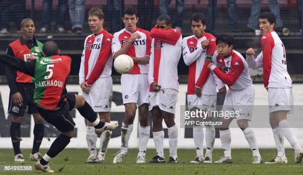 NEC Nijmegen's Youssef ElAkchaoui kicks a free kick as Feyenoord Rotterdam's football players defend during their national championship football...