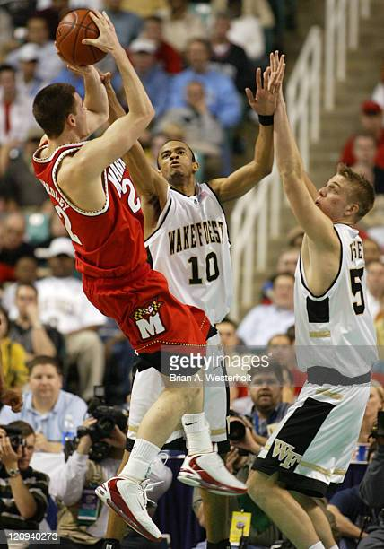 Nik Caner-Medley launches a jump shot over the out strecthed hands of Jamaal Levy and Kyle Visser during the second half of Maryland's 87-86 victory...