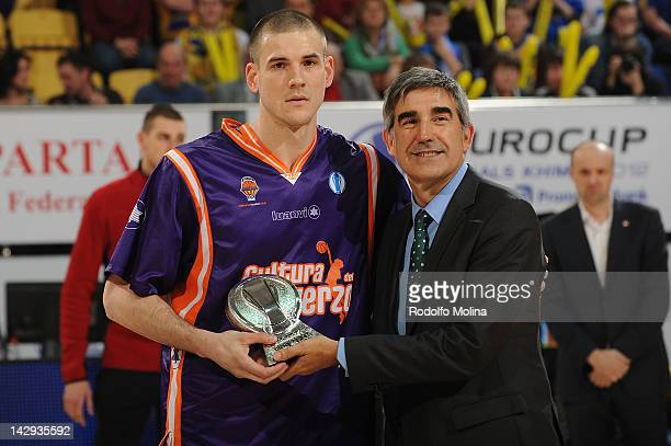 Nik Caner-Medley of Valencia Basket receives the 2011-2012 All-Euroleague First Team Trophy from Jordi Bertomeu, CEO of Euroleague Basketball during...