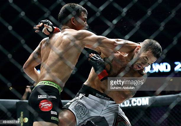 Nik Harris of Malaysia trades punches with Brad Robinson of the United States during OneFC Honor & Glory at Singapore Indoor Stadium on May 30, 2014...