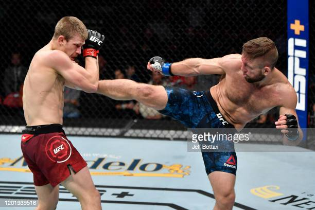 Nik Lentz kicks Arnold Allen of England in their featherweight bout during the UFC Fight Night event at PNC Arena on January 25 2020 in Raleigh North...