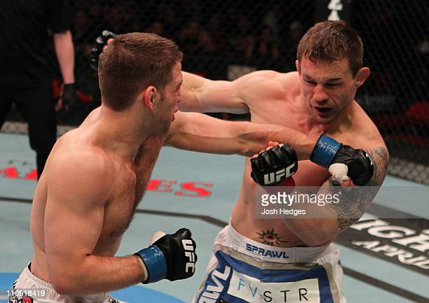 Nik Lentz punches Waylon Lowe during their lightweight bout at the UFC Fight Night 24 event at Key Arena on March 26 2011 in Seattle Washington