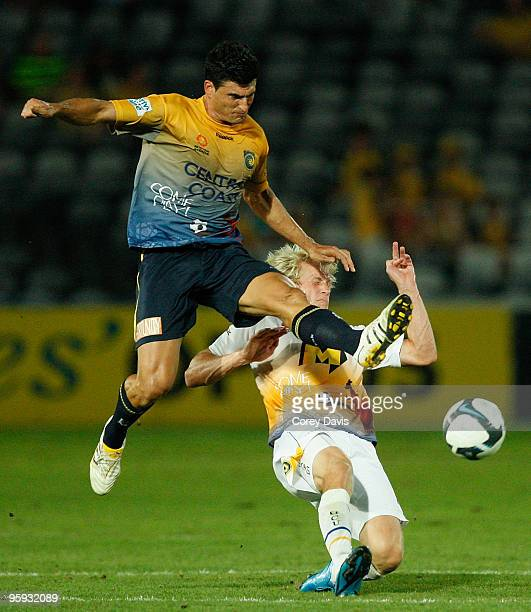 Nik Mrdja of the Mariners and Sebastian van den Brink of the Gold Coast contest the ball during the round 24 A-League match between the Central Coast...