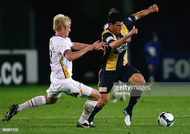 Nik Mrdja of the Mariners is challenged by Sebastiaan Van Den Brink of United during the round seven A-League match between the Central Coast...