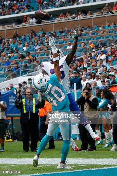 Nik Needham of the Miami Dolphins covers John Brown of the Buffalo Bills as he attempts to catch the ball for a touchdown during an NFL game on...