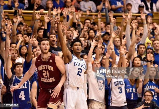 Nik Popovic of the Boston College Eagles and Cam Reddish of the Duke Blue Devils watch as a threepoint shot by Reddish drops through the net during...