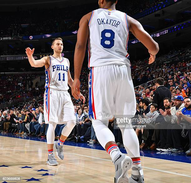 Nik Stauskas and Jahlil Okafor of the Philadelphia 76ers give each other fives after a play against the Washington Wizards during a game at the Wells...