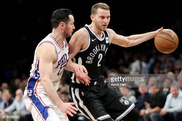 Nik Stauskas of the Brooklyn Nets works against JJ Redick of the Philadelphia 76ers in the first quarter during their game at Barclays Center on...