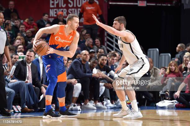 Nik Stauskas of the Cleveland Cavaliers handles the ball against Joe Harris of the Brooklyn Nets on February 13 2019 at Quicken Loans Arena in...