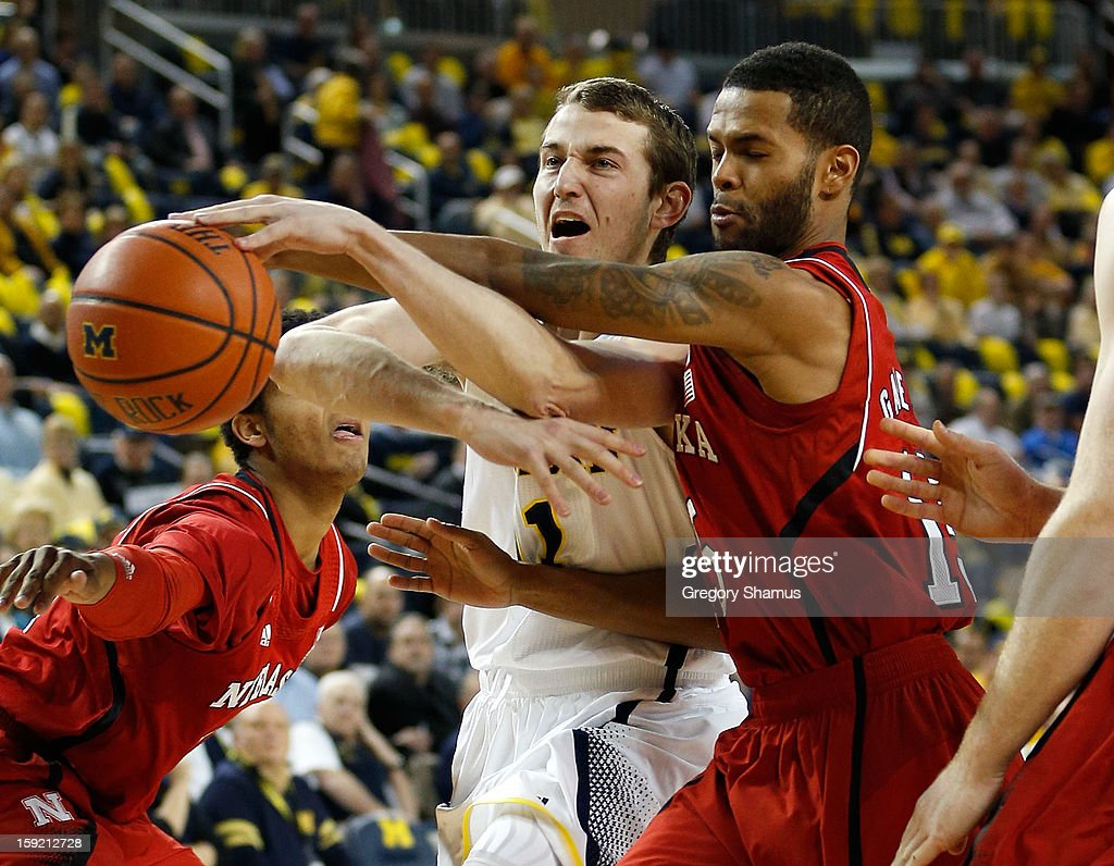 Nik Stauskas #11 of the Michigan Wolverines battles for the ball during the first half with Ray Gallegos #15 of the Nebraska Cornhuskers at Crisler Center on January 9, 2013 in Ann Arbor, Michigan. Michigan won the game 62-47.