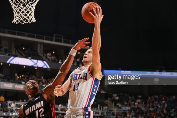 Nik Stauskas of the Philadelphia 76ers drives to the basket during the preseason game against the Miami Heat on October 13 2017 at Sprint Center in...