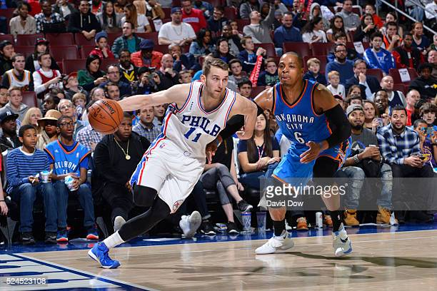Nik Stauskas of the Philadelphia 76ers drives to the basket while guarded by Randy Foye of the Oklahoma City Thunder at the Wells Fargo Center on...
