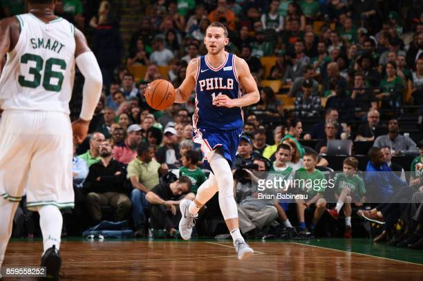 Nik Stauskas of the Philadelphia 76ers handles the ball against the Boston Celtics during the preseason game on October 9 2017 at the TD Garden in...