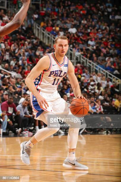 Nik Stauskas of the Philadelphia 76ers handles the ball during the preseason game against the Miami Heat on October 13 2017 at Sprint Center in...