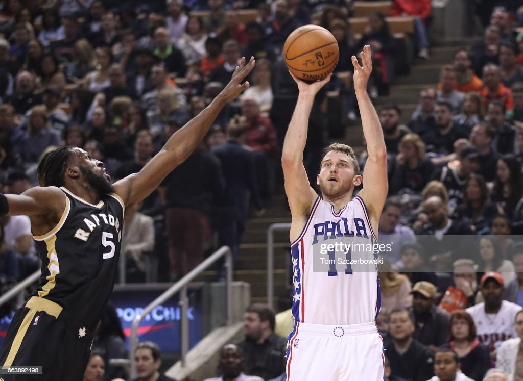 Nik Stauskas #11 of the Philadelphia 76ers shoots as DeMarre Carroll #5 of the Toronto Raptors attempts to defend during NBA game action at Air Canada Centre on April 2, 2017 in Toronto, Canada.