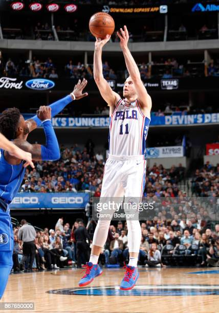 Nik Stauskas of the Philadelphia 76ers shoots the ball against the Dallas Mavericks on October 28 2017 at the American Airlines Center in Dallas...