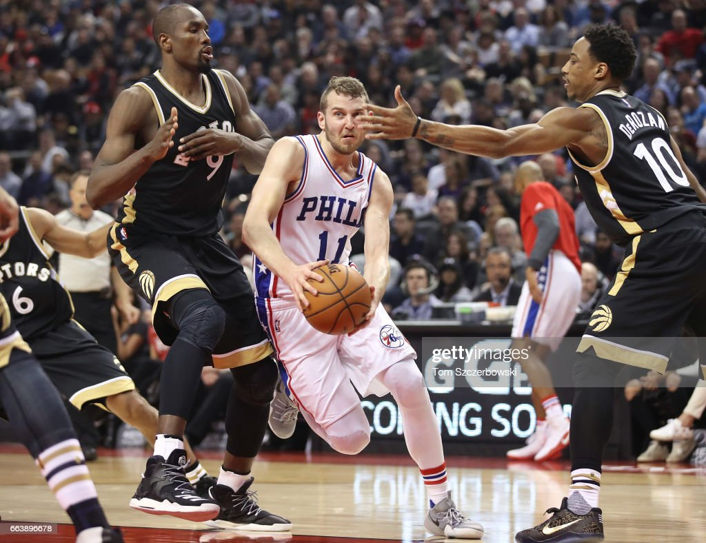 Nik Stauskas #11 of the Philadelphia 76ers tries to get past Serge Ibaka #9 of the Toronto Raptors and DeMar DeRozan #10 during NBA game action at Air Canada Centre on April 2, 2017 in Toronto, Canada.