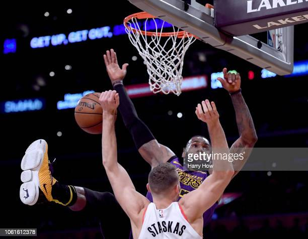 Nik Stauskas of the Portland Trail Blazers has his dunk blocked by LeBron James of the Los Angeles Lakers during a 126117 Laker win at Staples Center...